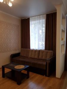 A seating area at Apartment on Mironenko