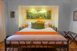 Cama o camas de una habitación en Finca Rosa Blanca Coffee Farm and Inn