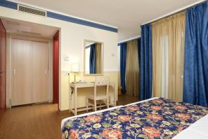 A bed or beds in a room at Villas Kornati