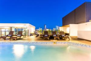 The swimming pool at or near Hotel Grand Chancellor Brisbane