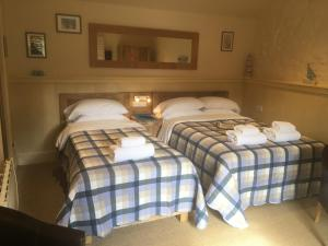 A bed or beds in a room at Widbrook Barns