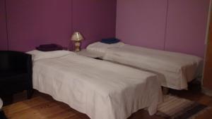 Säng eller sängar i ett rum på Nokipannu Bed and Breakfast