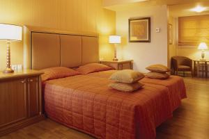 Ein Bett oder Betten in einem Zimmer der Unterkunft Divani Palace Larissa