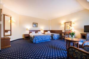 Кровать или кровати в номере Hotel Ossa Conference & Spa