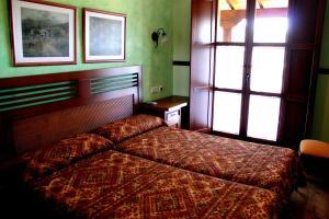 Cama o camas de una habitación en Hotel Rural El Verdenal