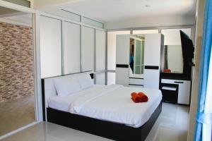 Ein Bett oder Betten in einem Zimmer der Unterkunft The Ri Hotel