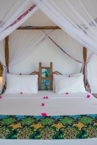 A bed or beds in a room at Warere Beach