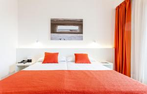 A bed or beds in a room at Intur Orange
