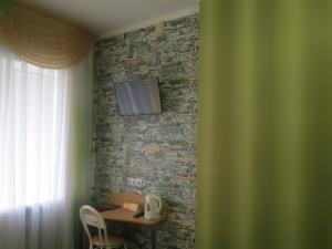 Телевизор и/или развлекательный центр в Гостиница Отель