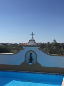 The swimming pool at or near Monte dos Aroeirais