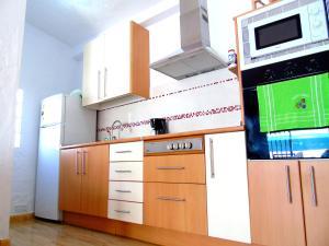 Una cocina o zona de cocina en bungalow Las TARTANAS I I