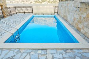 The swimming pool at or near Apartments Residence Portofino