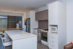 A kitchen or kitchenette at 19 Coast Drive