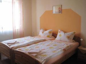 Кровать или кровати в номере Ferienpension Zum Hochscheid