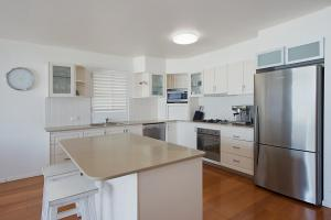 A kitchen or kitchenette at Palm Beach Beachfront Townhouse