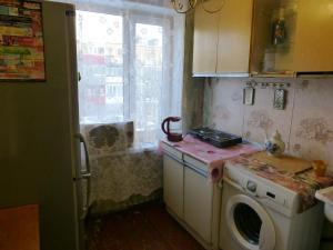 Кухня или мини-кухня в Апартаменты 5 Звезд