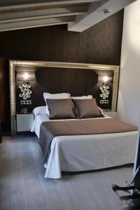 Cama o camas de una habitación en Hotel Rural Villa de Berlanga