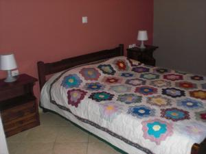 A bed or beds in a room at Vegera Apartment M
