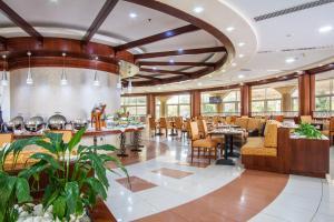 مطعم أو مكان آخر لتناول الطعام في فندق ومنتجع بريمير الشارقة