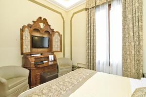 Letto o letti in una camera di Hotel Le Isole