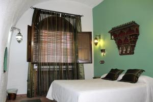 Cama o camas de una habitación en El Ventorro Hospederia Rural