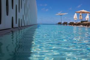 The swimming pool at or near Emiliano Rio