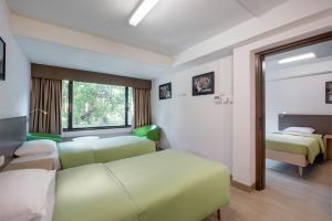 A bed or beds in a room at YHA Mei Ho House Youth Hostel