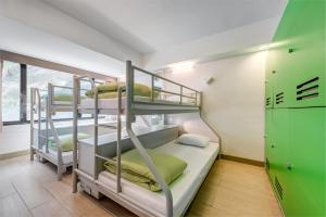 A bunk bed or bunk beds in a room at YHA Mei Ho House Youth Hostel