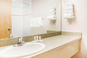 A bathroom at Super 8 by Wyndham Meadow Lake