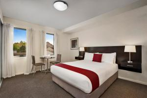 A bed or beds in a room at Quest Moonee Valley