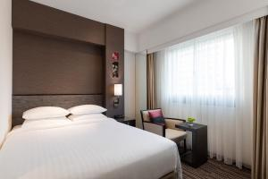 A bed or beds in a room at Courtyard by Marriott Tokyo Ginza