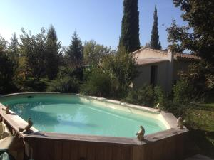 The swimming pool at or near Gourmandine