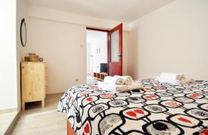 A bed or beds in a room at Apartment Mir