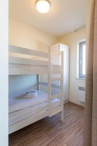 A bunk bed or bunk beds in a room at Aparthotel Blankenberge