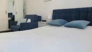 A bed or beds in a room at BTS Apartaments - Apartamenty Blisko Morza