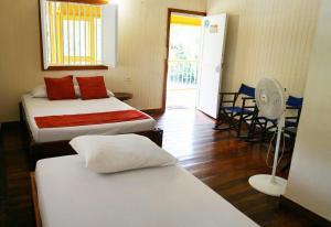 Un ou plusieurs lits dans un hébergement de l'établissement Eco-Hotel Kipara