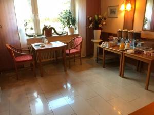 Een restaurant of ander eetgelegenheid bij Miles Hotel Berlin