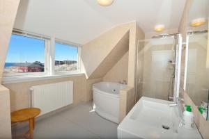 Ванная комната в Hotel Avannaa