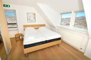 Кровать или кровати в номере Hotel Avannaa
