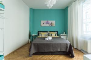 Postel nebo postele na pokoji v ubytování Central Apartments With Terrace