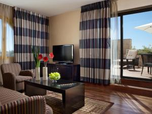 A television and/or entertainment center at Dan Panorama Jerusalem Hotel