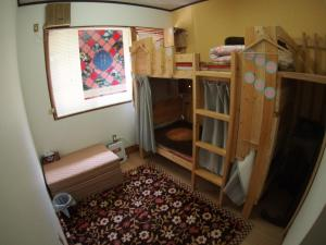 A bunk bed or bunk beds in a room at Ozu Shiromachi Guest house