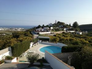 A view of the pool at Cortijo Clemente or nearby