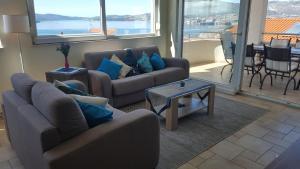 A seating area at Apartment Coasting Croatia