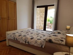 A bed or beds in a room at Apartments Siga