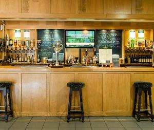 The lounge or bar area at Wensum Valley Hotel Golf and Country Club
