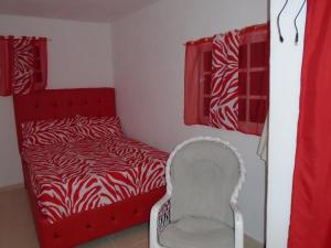 A bed or beds in a room at Guesthouse Villa La Isla