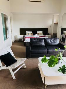 A bed or beds in a room at 107 Apartments Margaret River