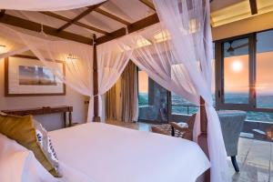 A bed or beds in a room at Melia Serengeti Lodge