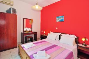 A bed or beds in a room at Mimoza